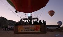 Balonlar kadına şiddete tepki için havalandı(video)