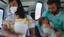 Bebeklerin kahramanı... Helikopterde bir an olsun kucağından bırakmadı