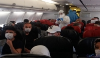Uçakta koronavirüs korkusu!İlk müdahaleyi kabin görevlileri yaptı.