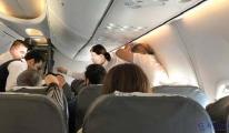 Uçakta öksürmek koronavirüsü tüm kabine yayıyor