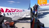 video Uçaktan inmek isteyen yolcuyu indirmediler!