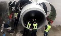 Yolcu uçağın motoruna bozuk para attı!