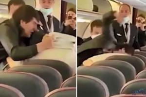 video Yolcu uçağında 'sosyal mesafe' kavgası