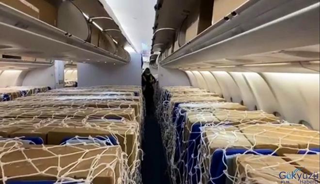 video Lufthansa,yolcu uçağında Almanya'ya maske taşıdı
